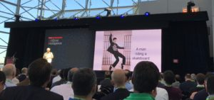 """Peter Norvig describes some amusing mistakes made by Google's Show and Tell when captioning images. Here, """"A man riding a skateboard"""" was generated for a picture of Elvis Presley."""